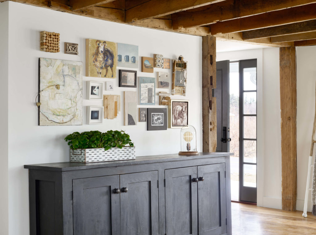 Farmhouse interior, art wall, gallery wall, family room design, art curation, local artists, ceiling beams, reclaimed beams, exposed wood ceiling, reclaimed posts, living room interior design, family room interior design, farmhouse designs, black cabinet, Kristina Crestin , Kristina Crestin Design, HGTV Farmhouse Fixer, HGTV Farmhouse